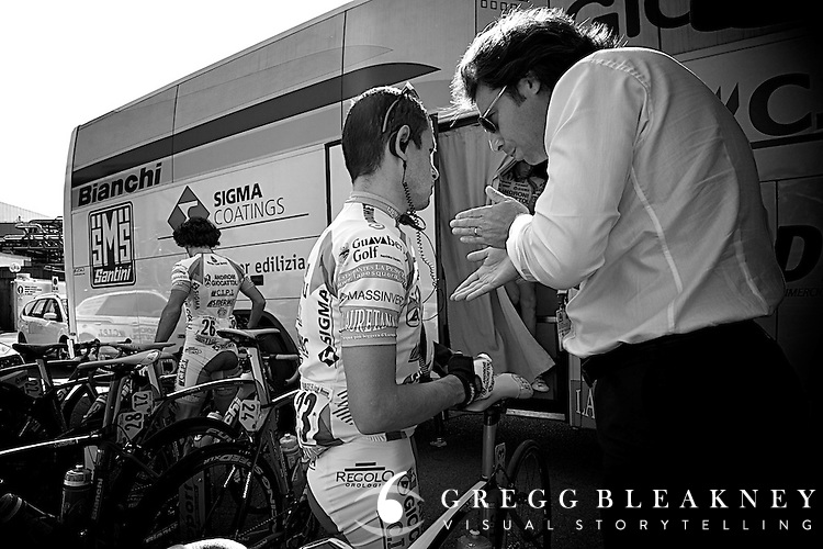10:31 -- Coach Marco Bellini has a short talk with Jose Rujano before the stage--reminding him to take it easy on the stage.