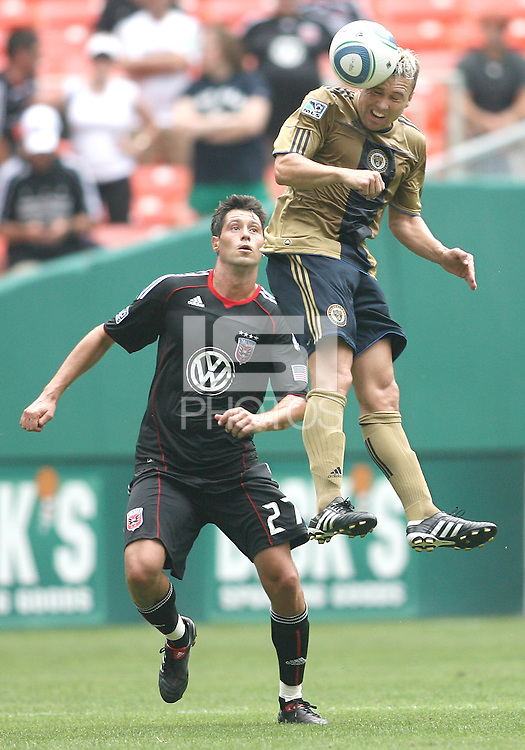 Branko Boskovic #27 of D.C. United watches Eduardo Coudet #21 of the Philadelphia Union head the ball during an MLS match at RFK Stadium on August 22 2010, in Washington DC. United won 2-0.