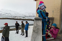 Kapisillit, Greenland - Local fishermen and their kids gather outside a grocery store in Kapisillit, Greenland, March 2016. Kapisillit is a settlement in the Sermersooq municipality in southwestern Greenland. In 2016, the settlement has about 60 inhabitants. Kapisillit means the salmon in the Greenlandic language. The name refers to the belief that the only spawning-ground for salmon in Greenland is a river near the settlement.