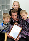Strathclyde Police Chief Constable's Bravery Awards - Dad's a hero! Nigel Abbott (correct spelling), who received the Chief Constable's Commendation for his action's relating to the Biggar bus crash - here with his children (l to r) Louie (8), Lilly (11) and Luke (9) - 29.10.10 - picture by Donald MacLeod - mobile 07702 319 738 - clanmacleod@btinternet.com - www.donald-macleod.com
