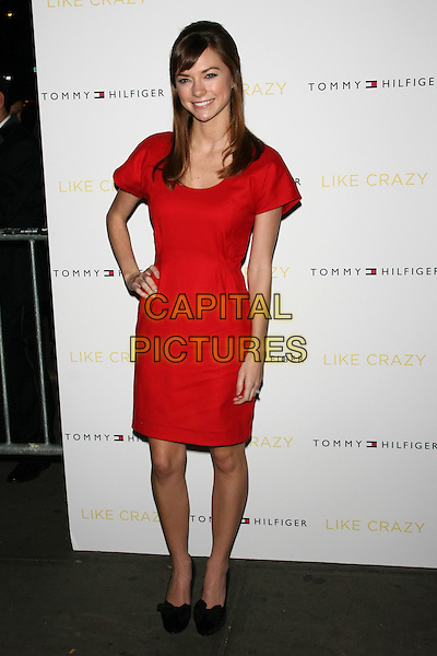 "Carrie MacLemore .The New York Premiere of ""Like Crazy"" at the Landmark Sunshine Cinema, New York, NY, USA..October 18th, 2011.full length red dress hand on hip.CAP/LNC/TOM.©TOM/LNC/Capital Pictures."