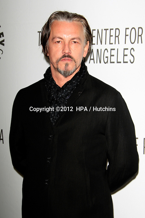 "LOS ANGELES - MAR 7:  Tommy Flanagan arrives at the ""Sons of Anarchy"" PaleyFest Panel at the Saban Theater on March 7, 2012 in Los Angeles, CA"