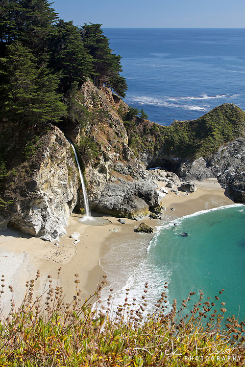 "McWay Falls in Julia Pfeiffer Burns State Park is an 80 foot waterfall that flows year-round. McWay Falls is one of only two waterfalls in the region that are close enough to the ocean to be referred to as ""tidefalls"". It is located on McWay Creek."