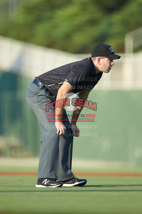 Umpire Drew Saluga handles the calls on the bases during the South Atlantic League game between the Hagerstown Suns and the Kannapolis Intimidators at Kannapolis Intimidators Stadium on July 16, 2018 in Kannapolis, North Carolina. The Intimidators defeated the Suns 7-6. (Brian Westerholt/Four Seam Images)