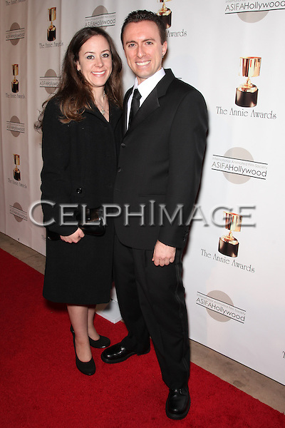 MICHELE SMITH, ROB FENDLER. Red Carpet arrivals to the 37th Annual Annie Awards Gala at Royce Hall on the UCLA campus. Los Angeles, CA, USA. February 6, 2010.