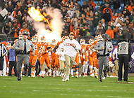 Charlotte, NC - December 2, 2017: Clemson Tigers head coach Dabo Swinney runs on the field before the ACC championship game between Miami and Clemson at Bank of America Stadium in Charlotte, NC.  (Photo by Elliott Brown/Media Images International) Clemson defeated Miami 38-3 for their third consecutive championship title.