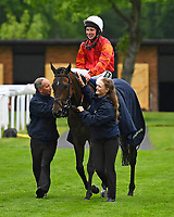 Many Dreams and jockey Jason Watson are led into the winners enclosure after winning The Shadwell Stud Racing Excellence Apprentice Handicap (Div 2), during Afternoon Racing at Salisbury Racecourse on 18th May 2017