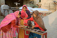 Women trained at the Barefoot College in Tilonia work on constructing large solar parabolas/cookers which focus the sun's rays onto cooking pots - rapidly bringing water or other ingredients to a boil without the need for firewood or other fuels. All the parts are locally available such as mirrors and bicycle gears adapted to turn the cooker on an axis tracking the sun's movement during the day. Solar cookers made by the college are being set up in remote rural villages and are maintained by local women...