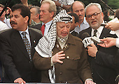Palestinian Authority Chairman Yasser Arafat speaks to reporters after his meeting with United States President Bill Clinton at the White House in Washington, DC on Thursday, June 15, 2000..Credit: Ron Sachs / CNP