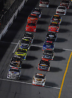 Feb 10, 2007; Daytona, FL, USA; Nascar Nextel Cup drivers Dale Jarrett (44) and Scott Riggs (10) lead the field to the green flag during the Budweiser Shootout at Daytona International Speedway. Mandatory Credit: Mark J. Rebilas