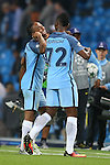 Raheem Sterling of Manchester City laughs with Kelechi Iheanacho of Manchester City during the UEFA Champions League Group C match at The Etihad Stadium, Manchester. Picture date: September 14th, 2016. Pic Simon Bellis/Sportimage