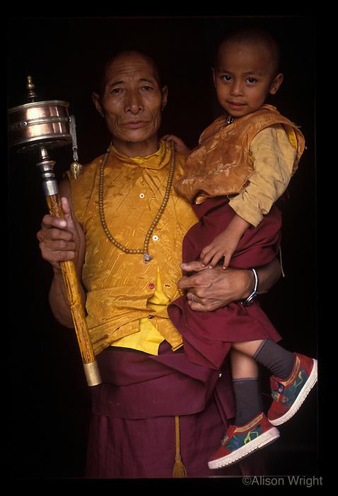 Nepal, Kathmnadu. Tibetan man and his grandon.