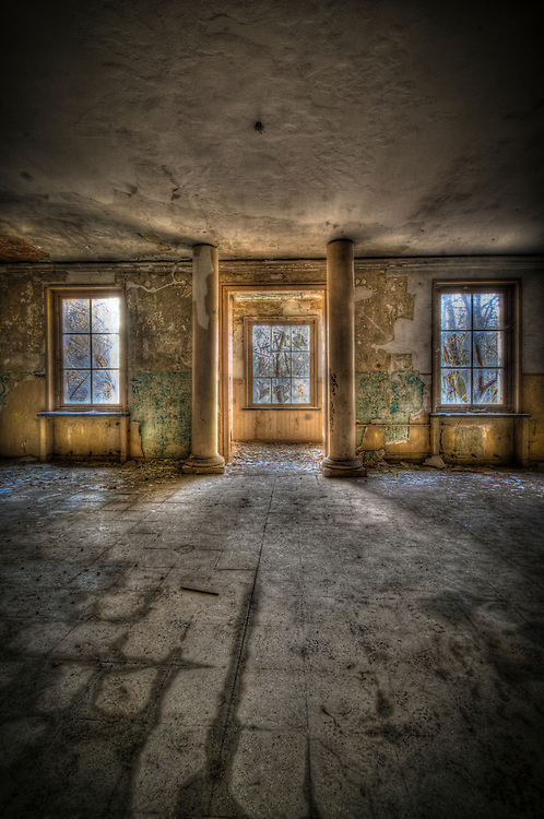 An empty room interior with grand columns in old tanks barracks somewhere near Berlin.