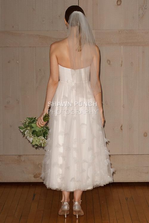 Model poses in a Cynthia Rowley bridal dress for the David's Bridal Fall 2017 fashion show presentation on April 19, 2017; during New York Bridal Fashion Week.