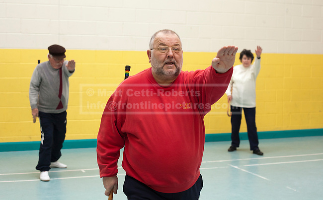 Kevin Garwood and two of his students, Colin (L) and Barbara (R) hold their hands up as a warning gesture to imaginary foes. Barbara, although not needing a walking stick for mobility, uses Cane Work as a way to retain as much movement as possible.
