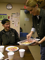 Jon Little.A volunteer serves fresh pancakes and ham to Brian Bearss, 730 a.m. March 9, 2006, at the McGrath checkpoint.