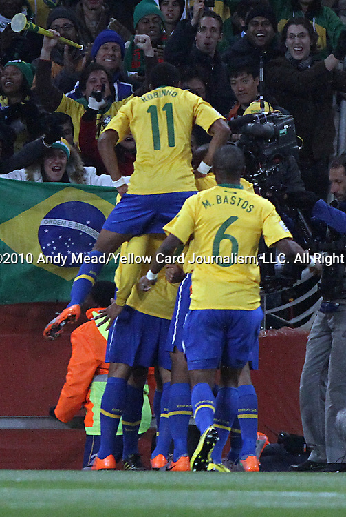 20 JUN 2010:  Robinho (BRA)(11) and Michel Bastos (BRA)(6) and teammates celebrate the goal scored by Luis Fabiano (BRA)(within back).  The Brazil National Team led the C'ote d'Ivoire National Team 1-0 at the end of the first half at Soccer City Stadium in Johannesburg, South Africa in a 2010 FIFA World Cup Group G match.