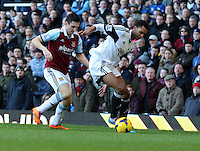 Pictured L-R: Stewart Downing of West Ham closely marking David N'Gog of Swansea. 01 February 2014<br />