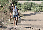 A girl carries water home from a river near Santa Paula, a hot and isolated village in northwestern Nicaragua.