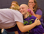 Sophomore Jessica Hicks smiles as she's hugged by volleyball player Guin Kohnz (left) and given a flower before the varsity volleyball match. The Block, Run, Kick & Drive Out Cancer volleyball match - which featured teachers playing teachers in a special JV game, and the Red Bud varsity team against the Valmeyer varsity team - was held at Valmeyer High School on Tuesday October 9, 2018. <br /> Tim Vizer/Special to STLhighschoolsports.com