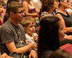 July 26, 2017. Raleigh, North Carolina.<br /> <br /> Jonas Hutchinson, age 8, listens to Alan Gratz discuss his new book &quot;Refugee&quot;.<br /> <br /> Author Alan Gratz spoke about and signed his new book &quot;Refugee&quot; at Quail Ridge Books. The young adult fiction novel contrasts the stories of three refugees from different time periods, a Jewish boy in 1930's Germany , a Cuban girl in 1994 and a Syrian boy in 2015.