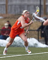 Syracuse University attacker/midfielder Kayla Treanor (21) on the attack from free position.  Syracuse University (orange) defeated Boston College (white), 17-12, on the Newton Campus Lacrosse Field at Boston College, on March 27, 2013.