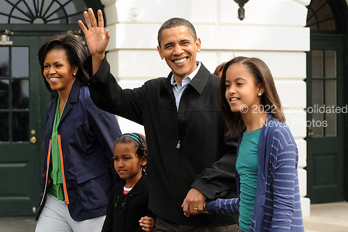 Washington, DC - April 13, 2009 -- United States President Barack Obama (2nd R) and first lady Michelle Obama (L) walk with their two daughters Natasha (2nd L) and Malia (R) to attend the Easter Egg Roll at the South Lawn of the White House in Washington DC, USA, Monday, 13 April 2009. .Credit: Michael Reynolds - Pool via CNP