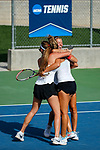 SURPRISE, AZ - MAY 11: Mara Cerrini, left, and Judith Bohnenkamp of the Barry Buccaneers rush to celebrate the team's win with Sonja Larsen during the Division II Women's Tennis Championship held at the Surprise Tennis & Racquet Club on May 11, 2018 in Surprise, Arizona. (Photo by Jack Dempsey/NCAA Photos via Getty Images)