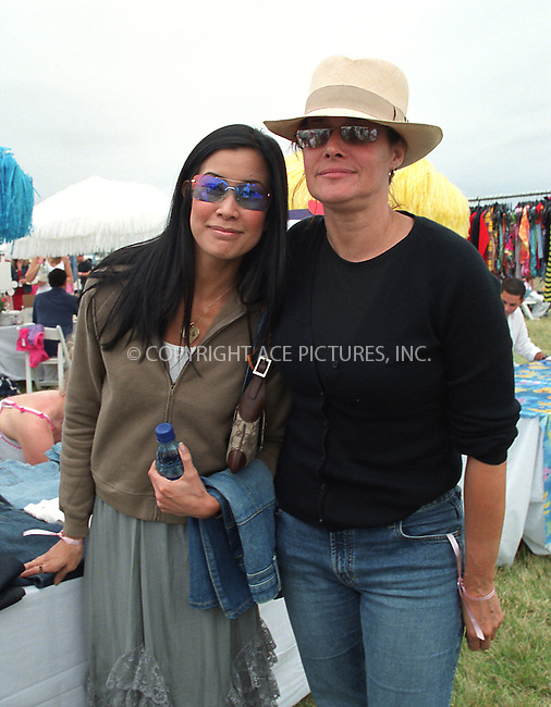 "Lorraine Bracco and Lisa Ling at the Fifth Annual ""Super Saturday"" designer sale and family event to benefit the ovarian cancer research fund. Water Mill, Long Island. July 27, 2002. Please byline: Alecsey Boldeskul/NY Photo Press.   ..*PAY-PER-USE*      ....NY Photo Press:  ..phone (646) 267-6913;   ..e-mail: info@nyphotopress.com"