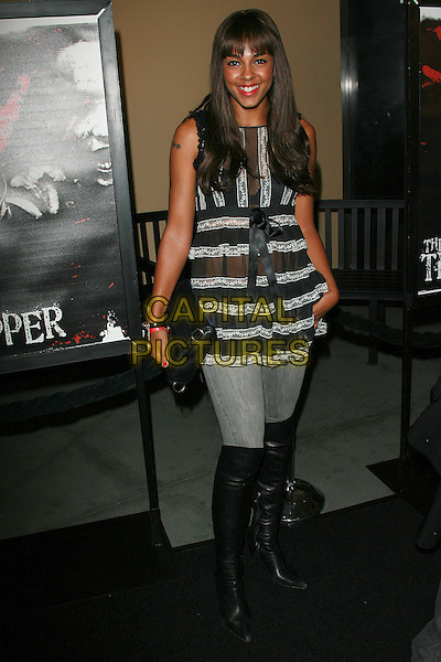 "MARSHA THOMASON.""The Tripper"" Los Angeles Premiere - Arrivals held at Mann's Chinese Theatre, Hollywood, California, LA, USA,.13 October 2006..full length black and white striped lace sheer top knee high boots tattoo fringe.Ref: ADM/ZL.www.capitalpictures.com.sales@capitalpictures.com.©Zach Lipp/AdMedia/Capital Pictures."