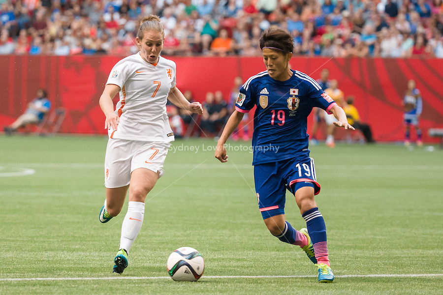 June 23, 2015: Manon MELIS of Netherlands and Saori ARIYOSHI of Japan compete for the ball during a round of 16 match between Japan and Netherlands at the FIFA Women's World Cup Canada 2015 at BC Place Stadium on 23 June 2015 in Vancouver, Canada. Japan won 2-1. Sydney Low/AsteriskImages.com