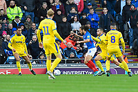 Marcus Harness of Portsmouth is surrounded by four AFC Wimbledon players during Portsmouth vs AFC Wimbledon, Sky Bet EFL League 1 Football at Fratton Park on 11th January 2020