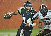 Florida International University Golden Panthers (0-5, 0-1 SBC)  versus the Troy University Trojans (3-2, 2-0 SBC) at the Orange Bowl, Miami, Florida on Saturday, October 6, 2007...Sophomore quarterback Wayne Younger (14) (Cocoa, Fla.) attempts to evade Troy defensive end Kenny Mainor (51) as the rain comes down in the fourth quarter.