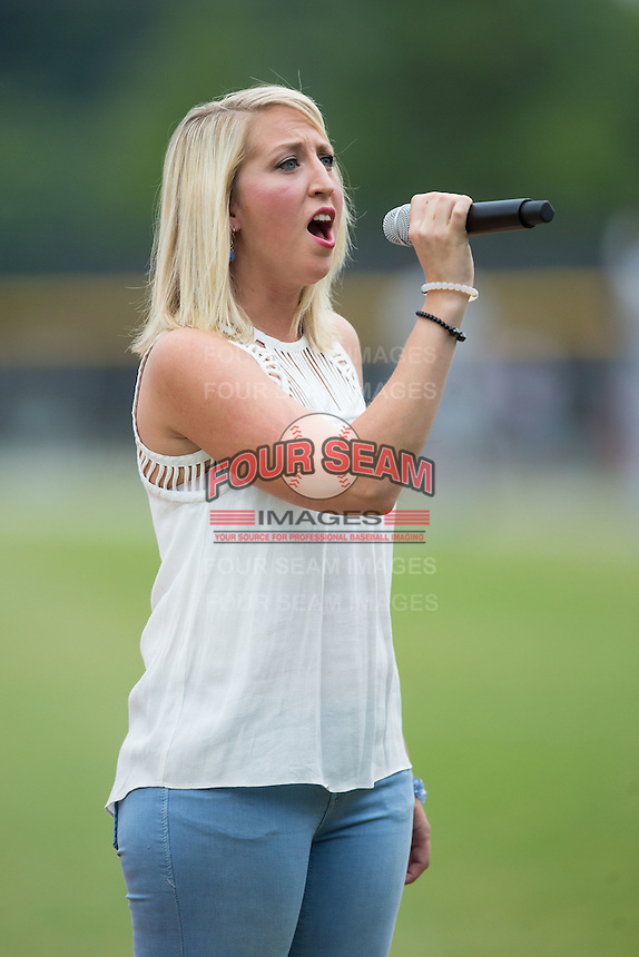 Gretchen Wiles sings the National Anthem prior to the Appalachian League game between the Bluefield Blue Jays and the Burlington Royals at Burlington Athletic Stadium on June 27, 2016 in Burlington, North Carolina.  The Royals defeated the Blue Jays 9-4.  (Brian Westerholt/Four Seam Images)