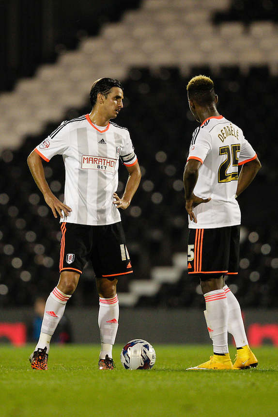 Fulham's Bryan Ruiz (left) &amp; Moussa Dembele get ready<br /> to re-start the game after conceding yet another goal<br /> <br /> Photographer Craig Mercer/CameraSport<br /> <br /> Football - Capital One Cup Fourth Round - Fulham v Derby County - Tuesday 28th October 2014 - Craven Cottage - London<br />  <br /> &copy; CameraSport - 43 Linden Ave. Countesthorpe. Leicester. England. LE8 5PG - Tel: +44 (0) 116 277 4147 - admin@camerasport.com - www.camerasport.com