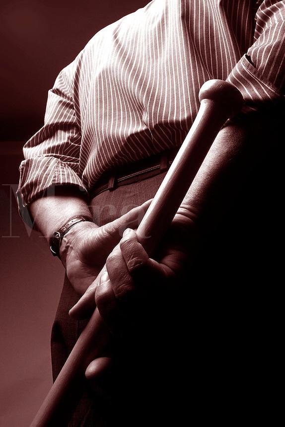 Businessman threatening with a baseball bat