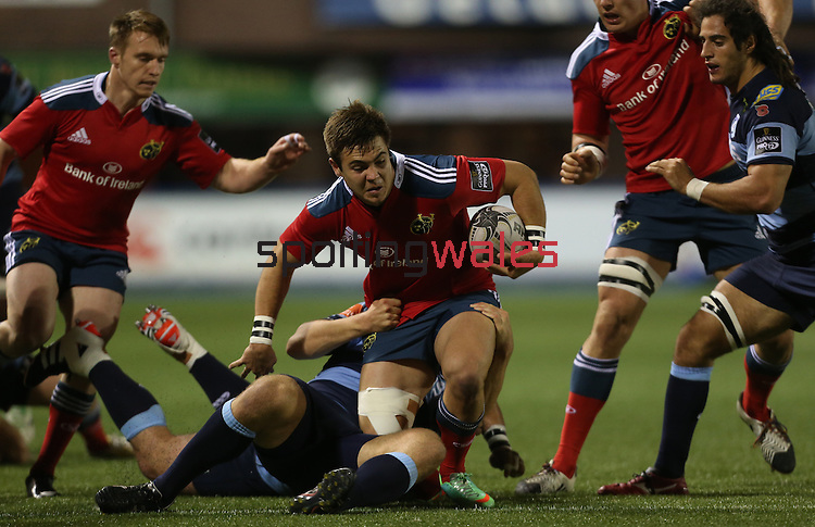 Munster wing Gerhard van den Heever is hauled down by Blues pair Adan Thomas and Adam Jones.<br /> Guiness Pro12<br /> Cardiff Blues v Munster<br /> Cardiff Arms Park<br /> 01.11.14<br /> ©Steve Pope-SPORTINGWALES