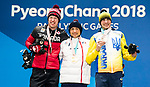 PyeongChang 10/3/2018 - Mark Arendz collects his bronze medal in the men's biathlon 7.5km standing during the medal ceremony at the PyeongChang Olympic Plaza during the 2018 Winter Paralympic Games in Pyeongchang, Korea. Photo: Dave Holland/Canadian Paralympic Committee