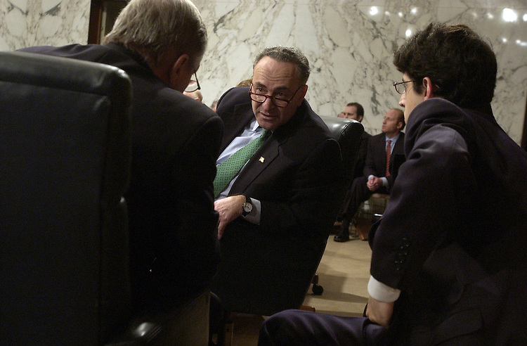 "Sen. Chuck Schumer, D-N.Y., center, has a word with Sen. Dick Durbin, D-Ill., left, and a staffer, during a Senate Judiciary Committee hearing on NSA spying entitled "" Wartime Executive Power and the NSA's (National Security Agency) Surveillance Authority,""  at which Attorney General Alberto Gonzales testified."