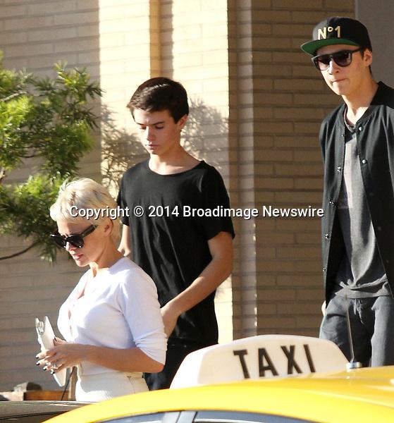 Pictured: Pamela Anderson, Brandon,  Dylan <br /> Mandatory Credit &copy; Patron/Broadimage<br /> Pamela Anderson leaving Barneys New York<br /> <br /> 2/5/14, Beverly Hills, California, United States of America<br /> <br /> Broadimage Newswire<br /> Los Angeles 1+  (310) 301-1027<br /> New York      1+  (646) 827-9134<br /> sales@broadimage.com<br /> http://www.broadimage.com