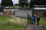 Two spectators arriving at Millburn Park, Alexandria, before Vale of Leven hosted Ashfield in a West of Scotland League Central District Second Division Junior fixture. Vale of Leven were one of the founder members of the Scottish League in 1890 and remained part of the SFA and League structure until 1929 when the original club folded, only to be resurrected as a member of the Scottish Junior Football Association after World War II. They lost the match to Ashfield by 4-3, having led 3-1 with 10 minutes remaining.