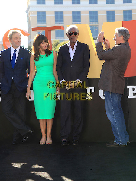 Kevin Kline, Mary Steenburgen, Morgan Freeman, Robert De Niro<br /> &quot;Last Vegas&quot; cast received the key to Vegas at the Bellagio Fountain, Las Vegas, NV, USA, 18th October 2013.<br /> full length green dress suit cast jeans beige brown grey gray blue iphone taking photo picture <br /> CAP/ADM/MJT<br /> &copy; MJT/AdMedia/Capital Pictures