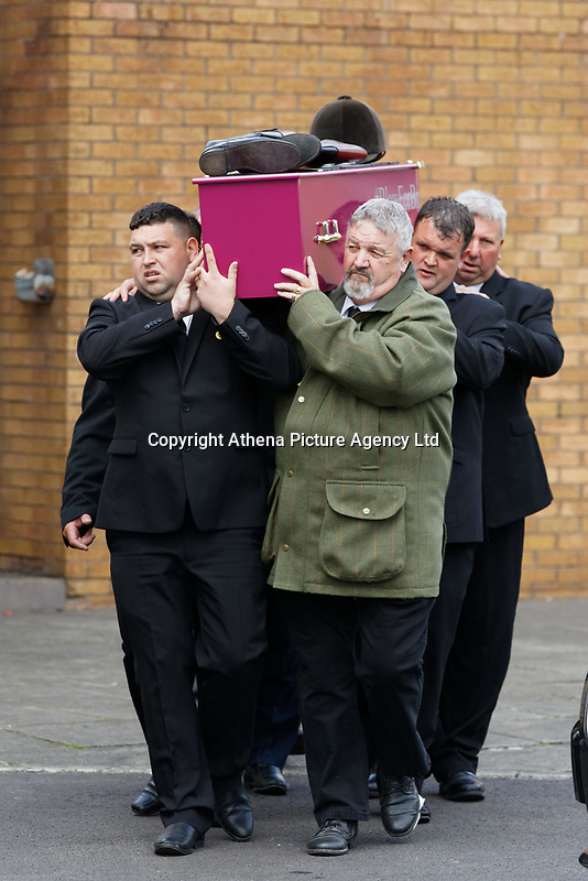 """Pictured: Pallbearers carry the coffin of Bradley John to a horse drawn carriage at Aberavon Beach Hotel, Wales, UK. Monday 08 October 218<br /> Re: A grieving father will mourners on horseback at the funeral of his """"wonderful"""" son who killed himself after being bullied at school.<br /> Talented young horse rider Bradley John, 14, was found hanged in the school toilets by his younger sister Danielle.<br /> Their father, farmer Byron John, 53, asked the local riding community to wear their smart hunting gear at Bradley's funeral.<br /> Police are investigating Bradley's death at the 500-pupils St John Lloyd Roman Catholic school in Llanelli, South Wales.<br /> Bradley's family claim he had been bullied for two years after being diagnosed with Attention Deficit Hyperactivity Disorder.<br /> He went missing during lessons and was found in the toilet cubicle by his sister Danielle, 12."""