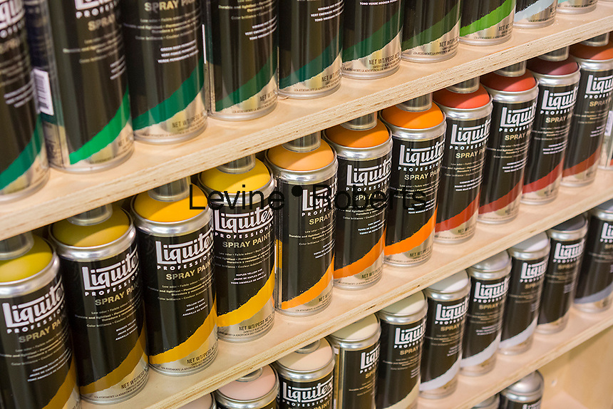 Unprotected except by a surveillance camera, aerosol cans of paint are on display in an art supply store in New York on Saturday, June 29, 2013. In an effort to thwart graffiti, store owners are required to keep aerosol cans of paint locked up, unlike this store, and are prohibited from selling them to minors. (© Richard B. Levine)