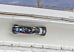 9 January 2016: United States of America pilot Codie Bascue leads his 4-man team as they cruise through Curve 14 during their second run of the day at the BMW IBSF World Cup Bobsled Championships at the Olympic Sports Track in Lake Placid, New York, USA. Bascue's team came in 15th for the day, with a 2-run combined time of 1:51.44. Mandatory Credit: Ed Wolfstein Photo *** RAW (NEF) Image File Available ***
