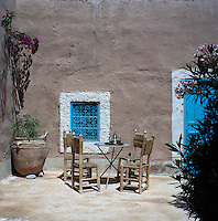 A pot of mint tea on a table in the corner of this Moroccan courtyard