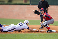 NJIT Highlanders first baseman Michael Anastasia (9) waits for a pick-off throw as Carson Jackson (10) of the High Point Panthers dives back towards the base during game one of a double-header at Williard Stadium on February 18, 2017 in High Point, North Carolina.  The Panthers defeated the Highlanders 11-0.  (Brian Westerholt/Four Seam Images)
