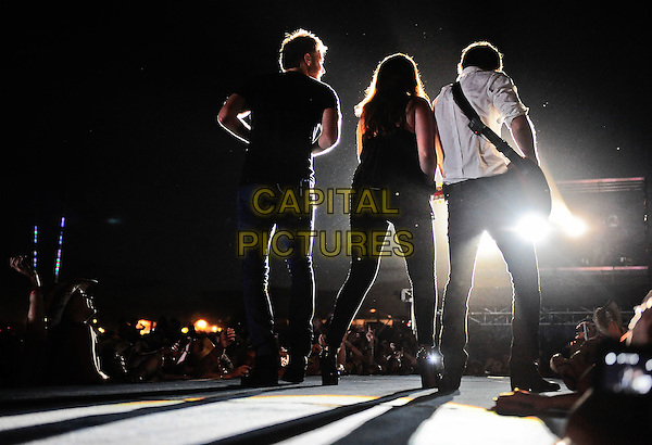 Lady Antebellum.Country Thunder, the four-day festival held July 21 - July 24 featuring entertainment from some of today's hottest artists rolls into town at Country Thunder East, Twin Lakes, Wisconsin, USA..July 21st, 2011.stage concert live gig performance music full length jeans denim black top back behind rear silhouette .CAP/ADM/RP.©Ryan Pavlov/AdMedia/Capital Pictures.