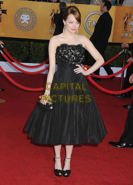Emma Stone.18th Annual Screen Actors Guild Awards held at The Shrine Auditorium, Los Angeles, California, USA..January 29th, 2012.SAG SAGS full length black strapless dress hand on hip lace clutch bag.CAP/ADM/BP.©Byron Purvis/AdMedia/Capital Pictures.