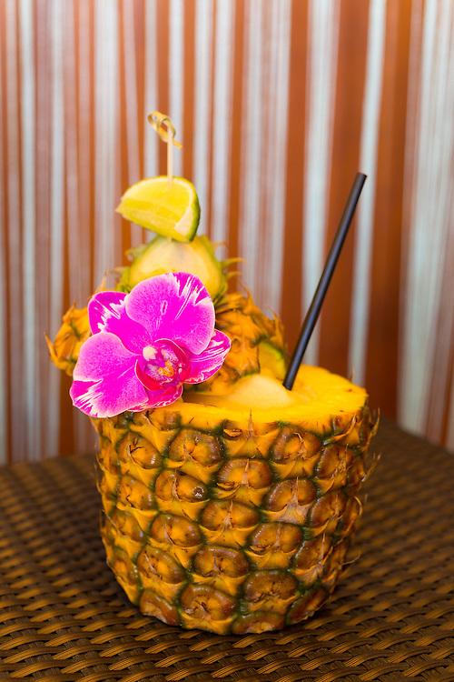 A Mai Tai served in a Pineapple at the Four Seasons Resort Maui at Wailea, Maui, Hawaii, USA